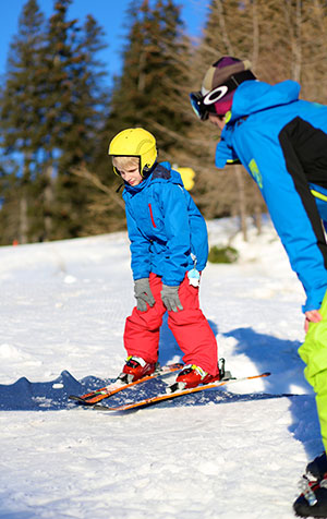 Kindvriendelijke wintersportbestemming Serfaus-Fiss-Ladis: skileraar en kind